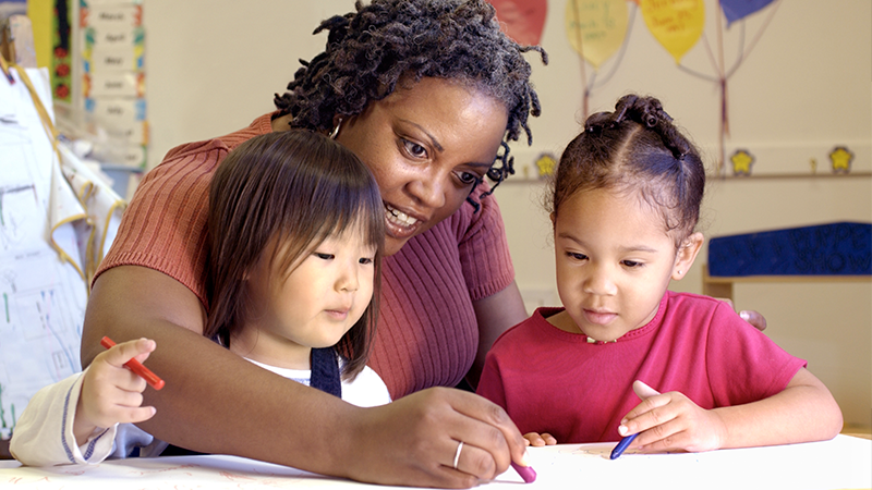 Childcare Teacher Coloring with Girls