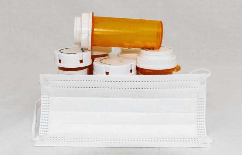 Pill bottles with a surgical mask around them