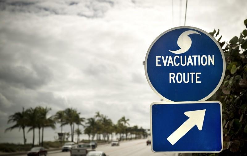 evacuation route sign stock photo