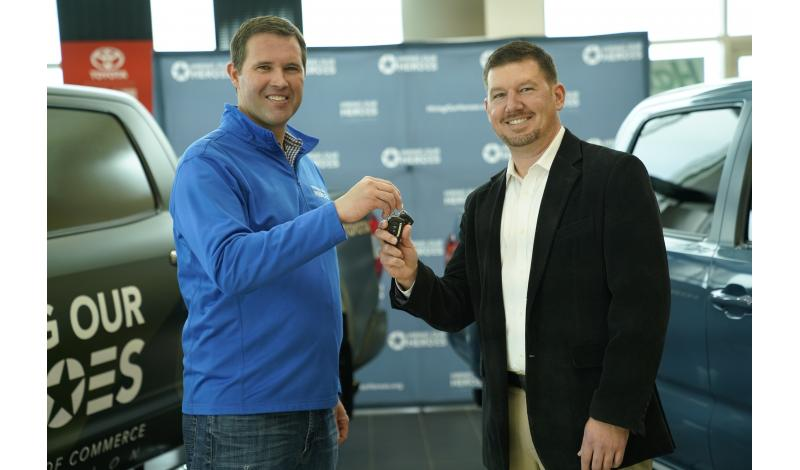 President of Hiring Our Heroes, Eric Eversole, hands the keys to Toyota Sweeps Winner Capt. (Ret.) James Saldanitro