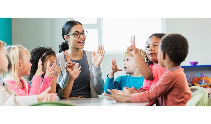 Preschool Teacher with Kids in Class